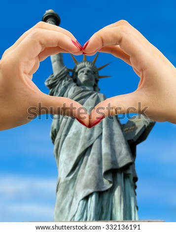 heart shape with hand with Liberty statue on the background - stock photo