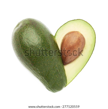 Heart shaped avocado fruit composition isolated over the white background - stock photo