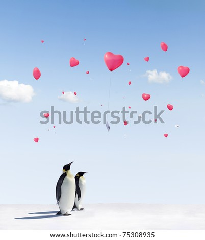 heart shaped Balloons flying over Emperor penguins in Antarctica - stock photo