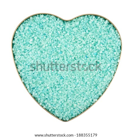 Heart shaped box filled with green colored salt crystals, isolated over the white background - stock photo