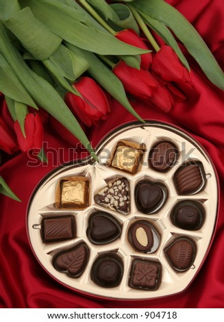 Heart Shaped Box of Candy and Tulips - stock photo