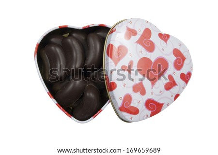 heart shaped box with pralines for your sweetheart on a white background - stock photo
