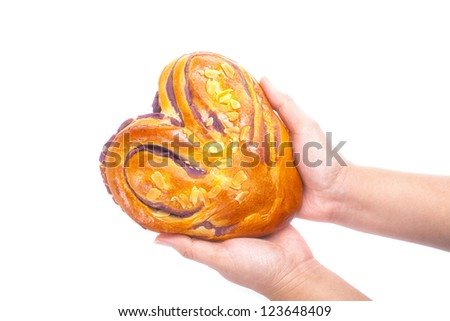 heart shaped bread with love in hands on white background - stock photo