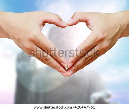 Heart Shaped Buddha Sky blurred bokeh background. Inspiration creativity mystery peaceful  Buddha Purnima Vesak Full Moon Poya Day Visakha Bucha Visak Bochea acceptance ensuring  security Concept - stock photo