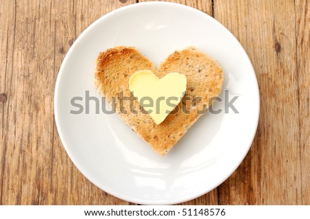 Heart shaped butter and toast - stock photo