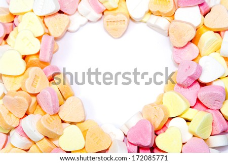 heart shaped candies with heart shaped white background - stock photo