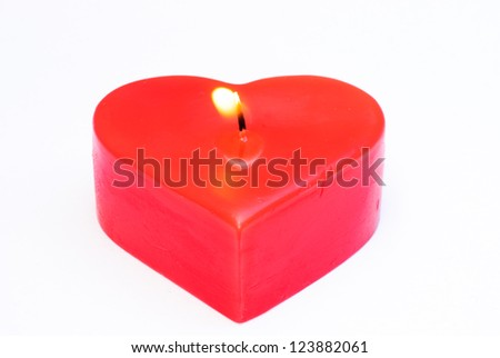 Heart shaped candles. On a white background. - stock photo