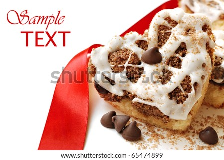 Heart shaped chocolate chip cinnamon coffee cake on white background with copy space.  Macro with shallow dof. - stock photo