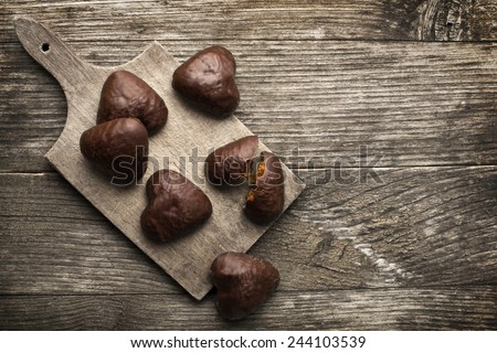 heart shaped chocolate cookies on a plate - stock photo