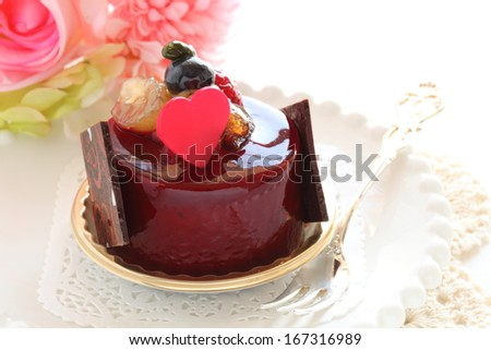 heart  shaped chocolate on raspberry cake for valentine's day dessert image - stock photo