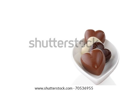 Heart-Shaped Chocolates in a White Dish with Room for Text for Valentine's Day - stock photo
