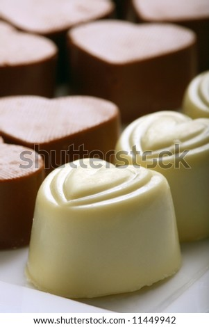 Heart-shaped chocolates. Short depth-of-field. - stock photo
