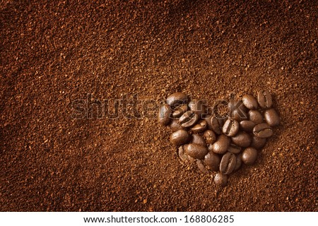 Heart shaped coffee beans - stock photo