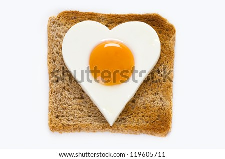 heart shaped cooked egg on a slice of toast - stock photo