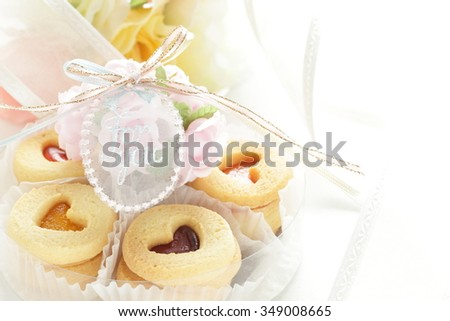 heart shaped cookie and ribbon - stock photo