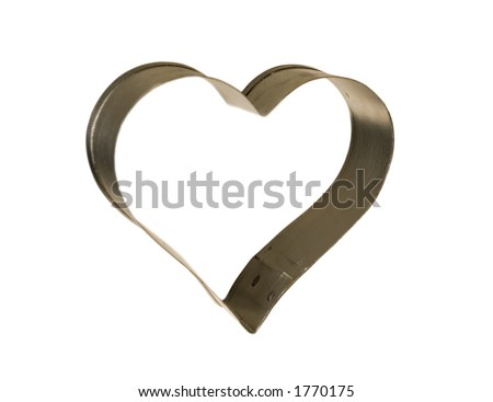 Heart shaped cookie cutter isolated on white. - stock photo