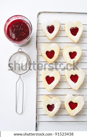 Heart shaped cookie on a cooling rack - stock photo
