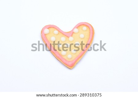 Heart shaped cookie with pink sugar icing isolated on white  - stock photo