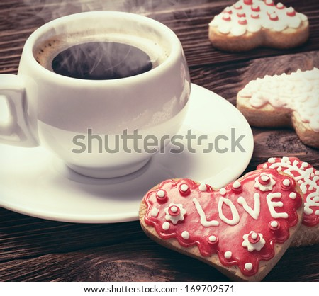 Heart shaped cookies baked on valentines day and a cup of coffee. toning technique - stock photo