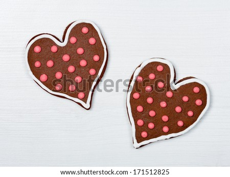 Heart shaped cookies on white wooden surface