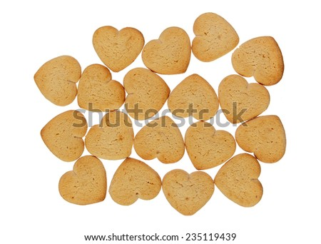 Heart shaped cookies pile isolated over white - stock photo