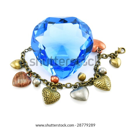Heart shaped crystal with braslet isolated on a white background - stock photo