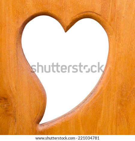 Heart shaped cut on wooden - stock photo