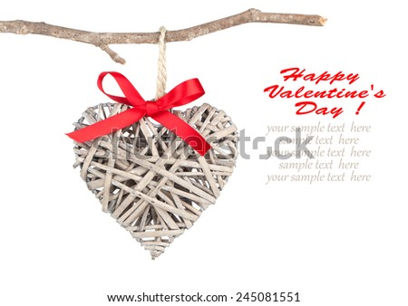 Heart shaped decoration made of wood, over white background - stock photo