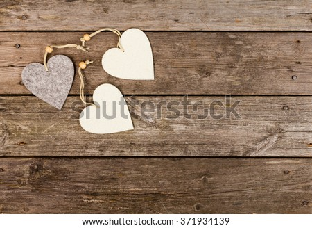 heart shaped decoration on wooden background - stock photo