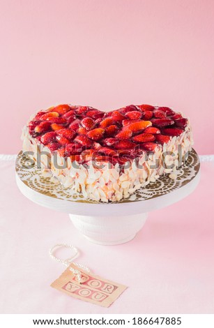Heart shaped decorative candy topped with roasted nuts served in a china pedestal with a label saying - For You - in a concept of love and romance for an anniversary or Valentines Day - stock photo
