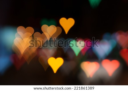 Heart-shaped defocused car lights, city night bokeh, Valentine's style lights - stock photo