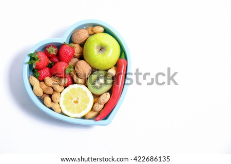 Heart shaped dish with vegetables isolated on white background - stock photo
