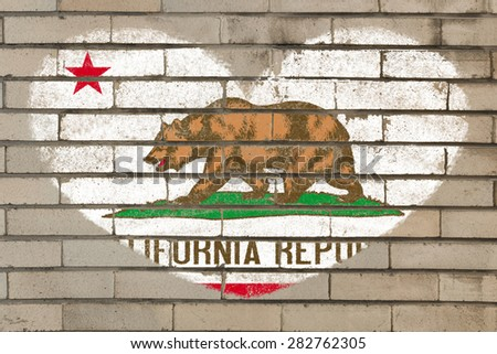 heart shaped flag in colors of california on brick wall - stock photo