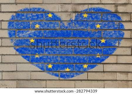 heart shaped flag in colors of europe on brick wall - stock photo