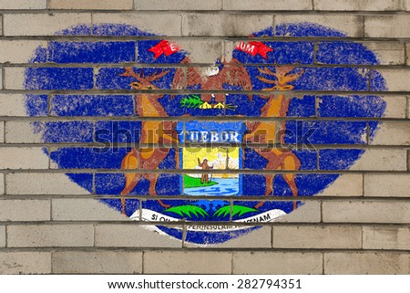 heart shaped flag in colors of michigan on brick wall - stock photo