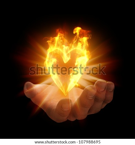 Heart shaped flame on a palm of a hand - stock photo