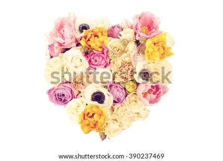 Heart shaped flower bouquet isolated on white background - stock photo