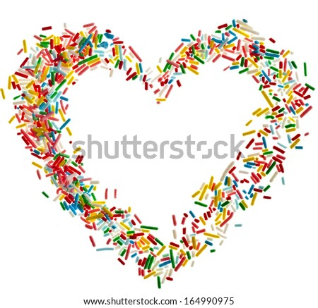 Heart shaped frame card made from colored sprinkles close up isolated on white background - stock photo