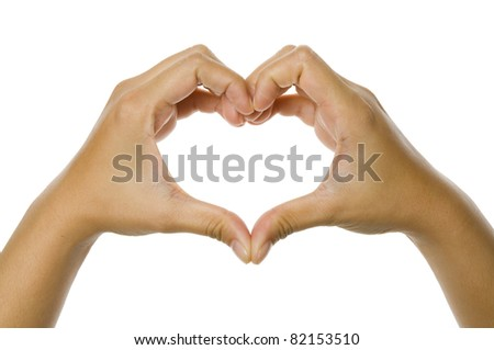 Heart shaped from woman hand isolated over white background - stock photo