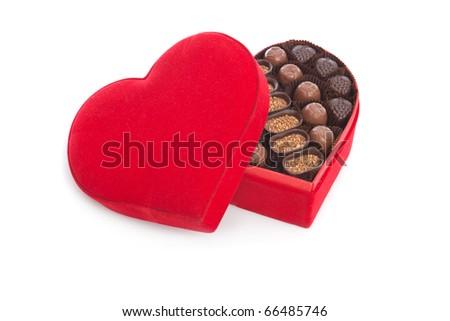 Heart shaped gift box having chocolates, shallow dof, selective focus - stock photo