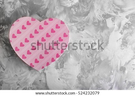 Heart shaped gift box on light background