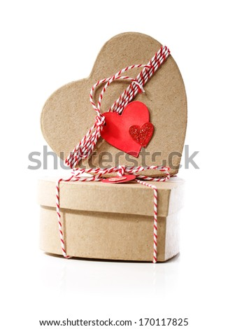 Heart shaped gift boxes with heart tags isolated on white background - stock photo