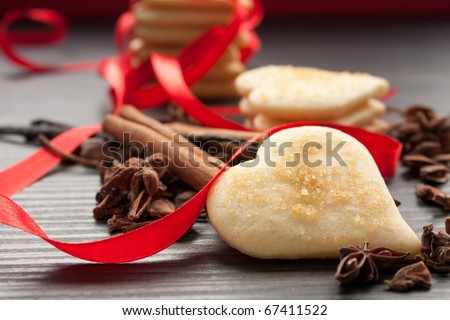 Heart shaped homemade butter cookies with aromatic spices. - stock photo