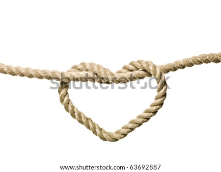 Heart Shaped Knot on a rope isolated - stock photo