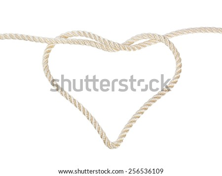 Heart shaped knot on a rope isolated on white background - stock photo