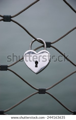 Heart shaped love padlock in Paris. Valentine's day background. - stock photo