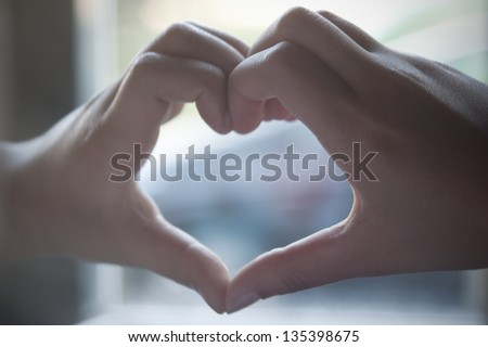 Heart shaped made by hands - stock photo