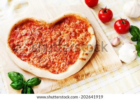 Heart-shaped Margherita Pizza - stock photo