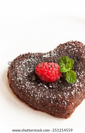 Heart shaped molten lava cake isolated on white - stock photo