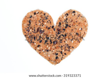 Heart-shaped Multigrain bread isolated on white. - stock photo